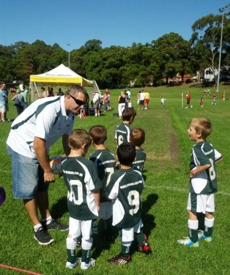 Coach Cameron giving the 6Bee2s their pre-game pep talk